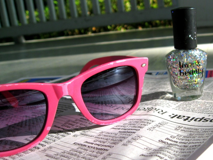 sunglasses and glitter nail polish