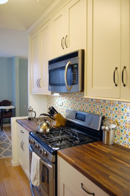 Yellow cabinet kitchen with colorful backsplash