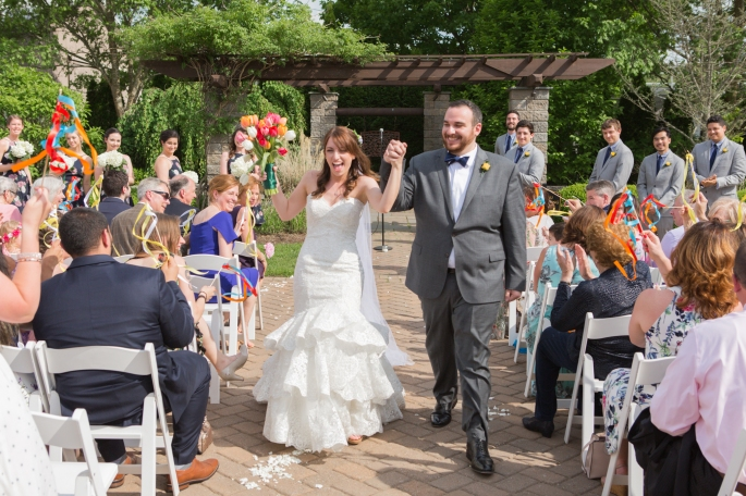 Walking back up the aisle after getting married | The Cheerful Times